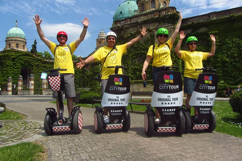 Zagreb tour - Zagreb Leisure Tour - four people driving segway at Mirogoj